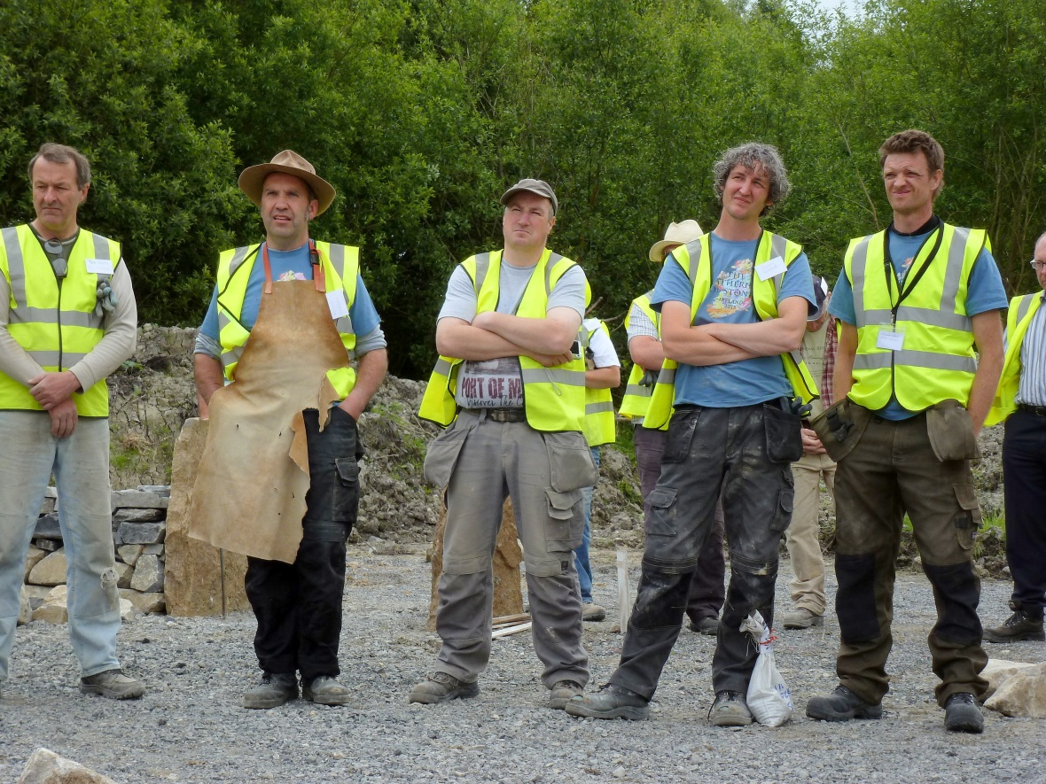 Stonemasons listen to speeches