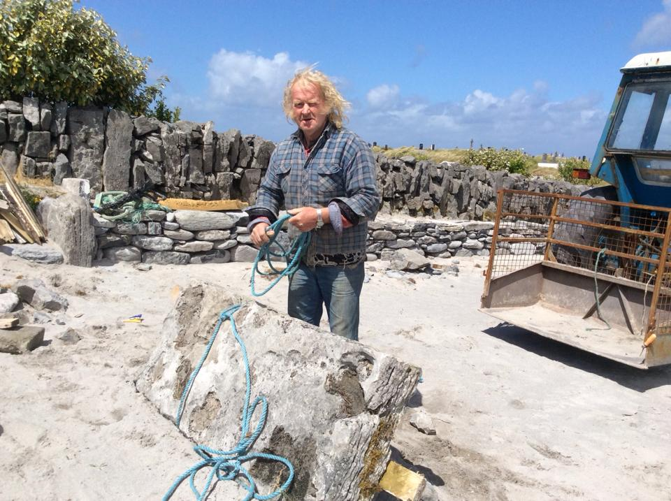 Padraig Poil gets ready to ship his contribution of limestone
